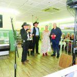 Los Pistoleros present their donations