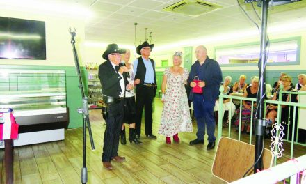 Los Pistoleros present their donations